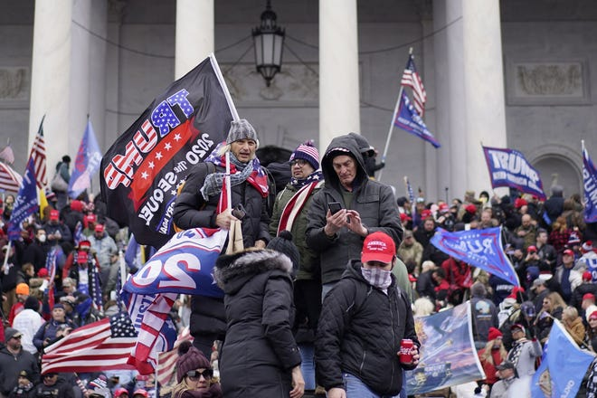 Protesters storm the Capitol and halt the joint session of the 117th Congress for the counting of electoral votes, Jan. 6, 2021.