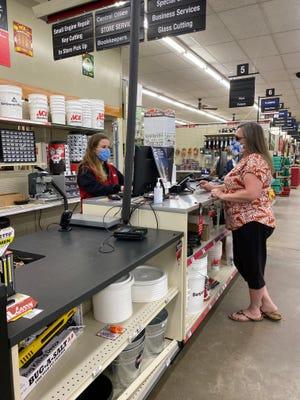 Skaggs Ace Hardware employee Sarah Skaggs, left, helps customer Anissa Potters.