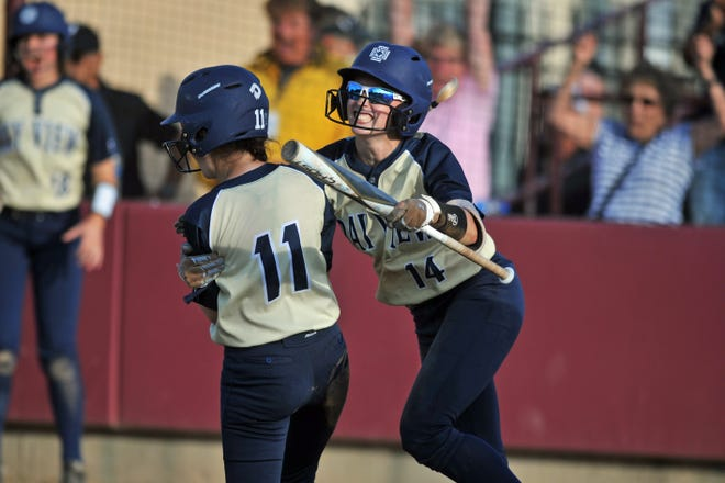 Bay View's Emily Heath, right, hugs Ashley Anderson, who scored on Sage Verkler's triple in the ninth inning of the Bengals' 2-0 win over Scituate on Friday.
