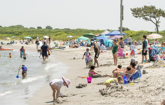 In this file photo from July 2018, beachgoers relax, play and cool off at Middletown's Third Beach, but on Thursday, the Rhode Island Department of Health recommended closing the beach for swimming because of high bacteria levels.
