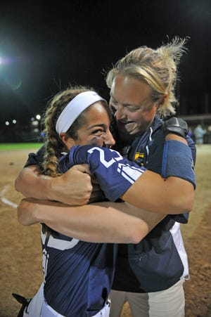 Burrillville/North Smithfield's Jade Guertin, left, gets a hug from assistant coach Lindsay Lacey after the Broncos beat Mt. Hope on Thursday to claim the D-III title.