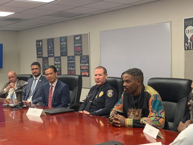 Attorney General Rob Bonta, second from left, meets with Stockton Mayor Kevin Lincoln, left, Police Chief Eric Jones, and other city officials during a roundtable Thursday to discuss violence prevention efforts in the city.