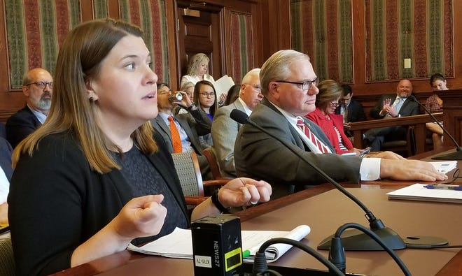 Angie Postal, left, of Planned Parenthood testifies Thursday against a bill that would ban her organization from providing state-paid family planning services and limit the types of contraceptives available to Medicaid recipients, while the sponsor, Sen. Dan Hegeman, listens. Rudi Keller/Missouri Independent