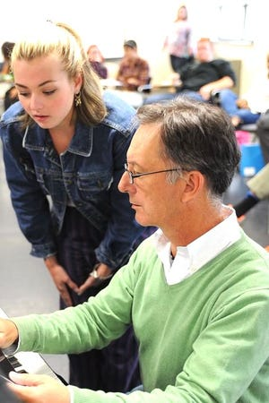 Jonathan Swoboda, music director at Porthouse Theatre at Blossom Music Center and at Kent State University's School of Theater and Dance, works with a Kent State student.