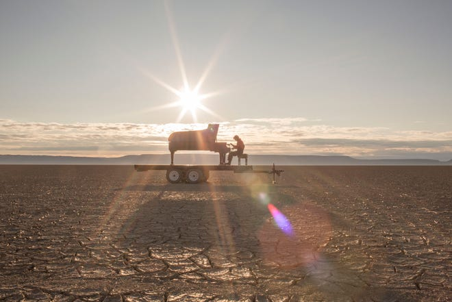 """""""In a Landscape"""" pianist Hunter Noack performing in the Alvord Desert."""