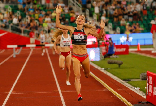 Emma Coburn throws her hands up as she crosses the finish line, winning the 3,000-meter steeplechase in meet-record time during the U.S. Olympic Track & Field Trials at Hayward Field on Thursday.