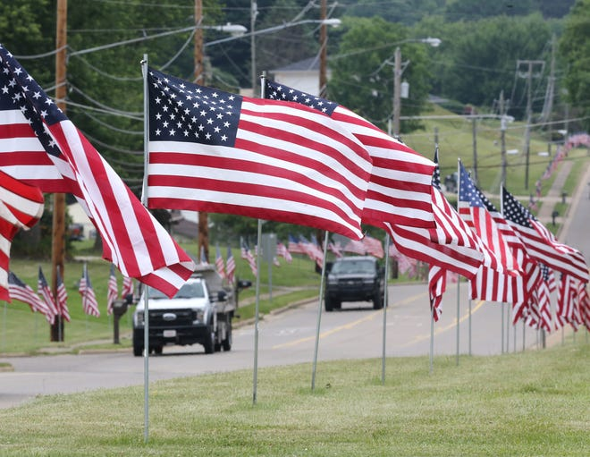 Flags line Faircrest Street SW in Canton Township as the township readies for Saturday's Community Day.