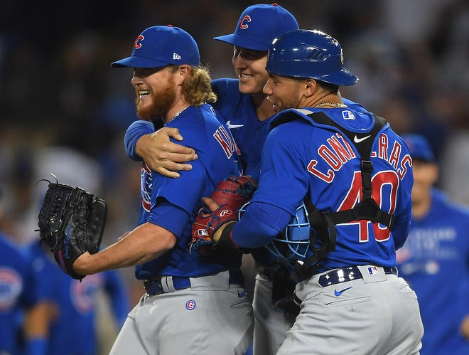 Chicago Cubs relief pitcher Craig Kimbrel (left) is congratulated by first baseman Anthony Rizzo (center) and catcher Willson Contreras (40) after Kimbrel pitched a scoreless ninth inning to complete a combined no-hitter against the Los Angeles Dodgers Thursday night.