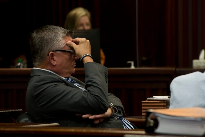 Chatham County Manager Lee Smith holds his head during the Chatham Commission meeting on Friday. Chatham County will not meet the deadline to pass their 2022 budget after failing to do so on Friday.