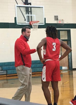 Effingham County High School boys basketball coach Jake Darling talks to Timmy Brown during a timeout last season. Darling orchestrated a 13-team, round-robin summer basketball tournament June 23-24 at the Clarence E. Morgan Central Recreation Complex.