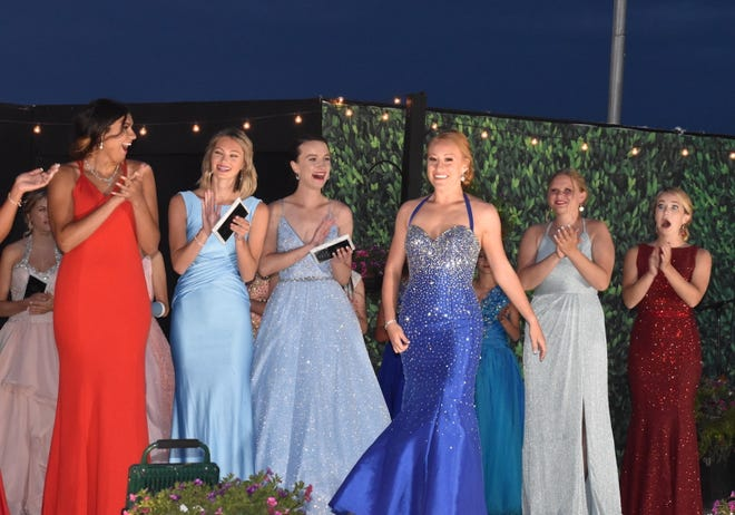 Contestants react after Katie Noyd, center, is announced as the 2021 Miss Henry County Fair on Tuesday, June 22, at the grandstand in Cambridge. From left: Ailynn Duarte, Keagan Rico, Rose Henderson, Noyd, Taylor Warner and Claire McLoone.