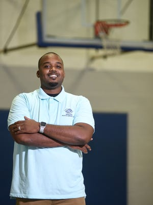 Rashad Gattison, Teen Service Director at the Brigade Boys and Girls Club, stands on the Brigade's basketball court in Wilmington, N.C., Friday, June 25, 2021. Gattison is one of the StarNews 40 Under 40 honorees for 2021. [MATT BORN/STARNEWS]