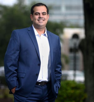 Joseph Casares, Director of Radiology at Novant Health New Hanover Regional Medical Center, stands in front of the hospital in Wilmington, N.C., Friday, June 25, 2021. Canavan is one of the StarNews 40 Under 40 honorees for 2021.