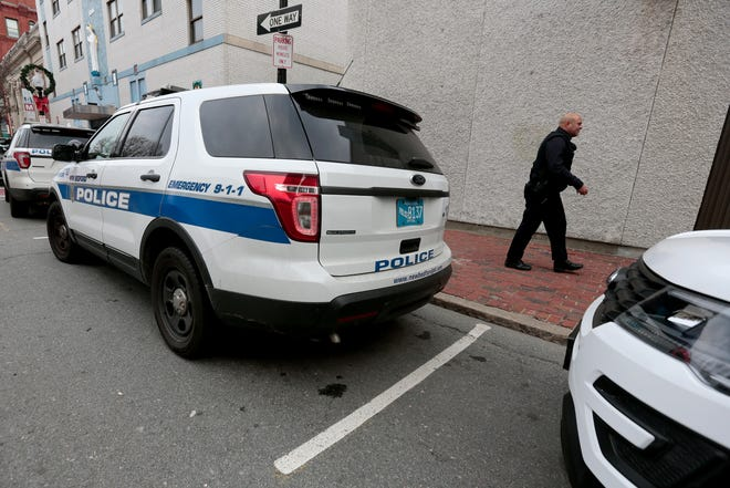 New Bedford police vehicles are seen parked downtown outside the station at 572 Pleasant St. is seen in this 2018 file photo.