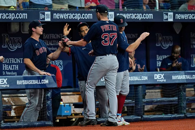 Boston Red Sox pitcher Nick Pivetta (37) is congratulated by teammates after being taken out of the game against the Tampa Bay Rays with a no-hitter Thursday in St. Petersburg, Fla.