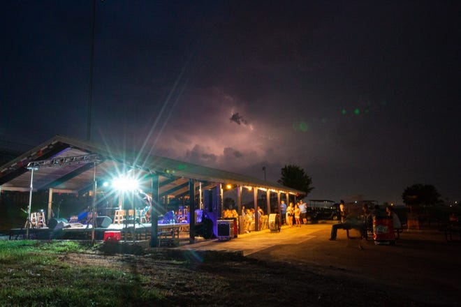 Storms move across the skies Thursday over the Songwriters Stage at Country Stampede. The stage, alongside the Tuttleville Stage, helps lesser-known country musicians get their music out to fans and potential fans.