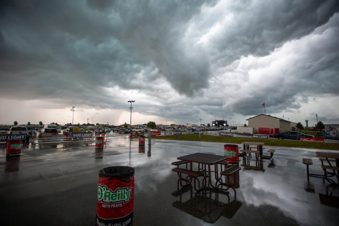 Strong winds bring a large storm cell over the Country Stampede festival grounds at Heartland Motorsports Park on Friday afternoon. Volunteers had to scramble earlier in the day to clean up tents and debris from the follow night's storms.
