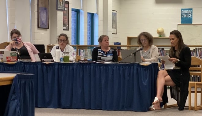 During a meeting earlier this year, members of the Dudley-Charlton Regional School Committee listen as Kathleen Berry, a parent, expresses concerns over whether critical race theory is being taught in the district's schools.