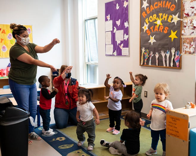 Children sing and dance in the toddler room at the YWCA of Central Massachusetts on Friday in Worcester.