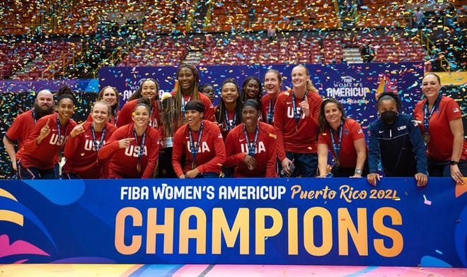 Aliyah Boston, center, holds the FIBA Women's AmeriCup championship trophy along with her Team USA teammates, after defeating Puerto Rico in San Juan.