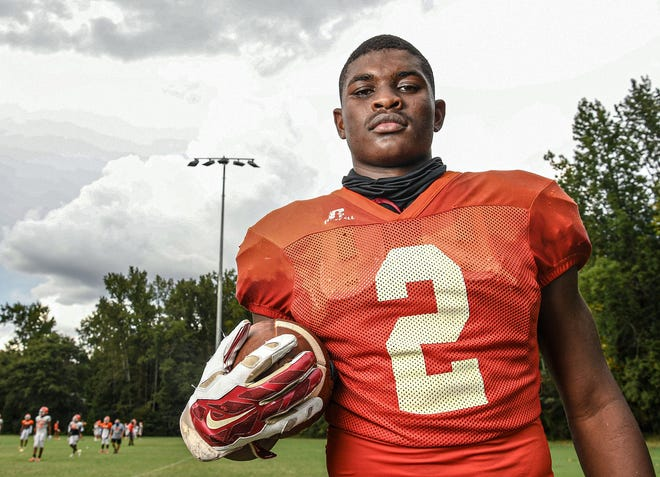"""Mauldin High School linebacker/safety Randy """"Deuce"""" Caldwell II poses for a portrait in September 2020 ahead of the Mavericks' season. Caldwell, a three-star 2022 recruit and the No. 16 rising senior in South Carolina, committed on Friday to UNC football over UCF."""