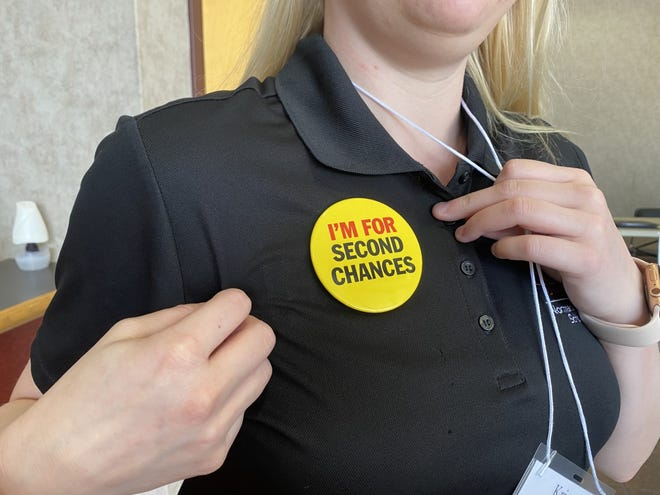 Recent law graduate student Kristen Longmire wears a pin to support the NC Second Chance Alliance, a non-profit working to address the barriers of criminal records in the state.