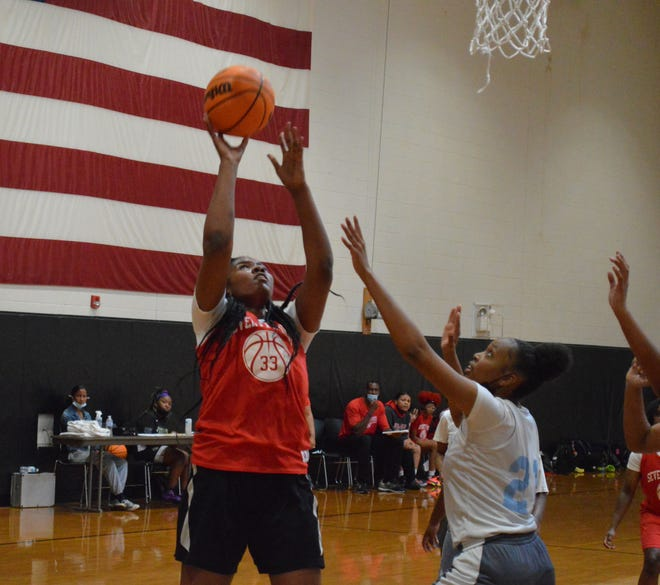 Kyleigh Goode (33), a rising sophomore at Seventy-First, showed off her scoring ability at Gray's Creek's summer jamboree.