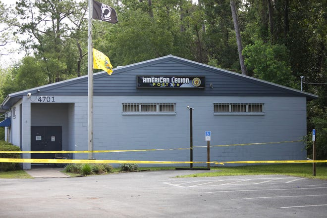 Police tape encircles American Legion Post 16 in Gainesville, where five teens were shot during a party overnight on June 25.