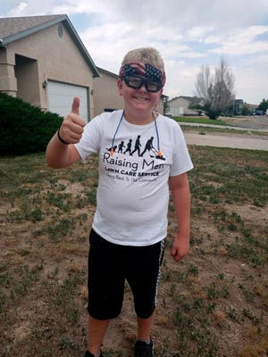 Kaden Ravencamp set a goal to give back to the community through completing a 50 yard challenge this summer.