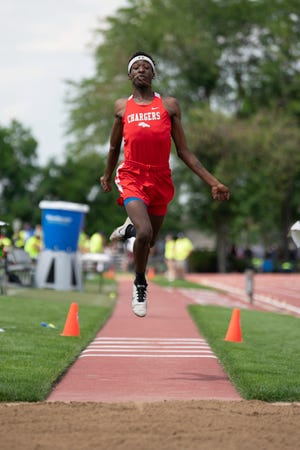 Crowley County's Rashaun McNeil extends on the last step during the triple jump at the Class 2A state track and field meet at Jefferson County Stadium on Thursday June 24, 2021.