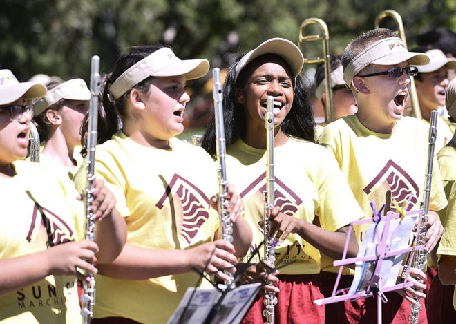 Members of the Sun City Band take a tune-up practice session in August 2014 in Mineral Palace Park in preparation for the Douglas County Fair Parade in Castle Rock.