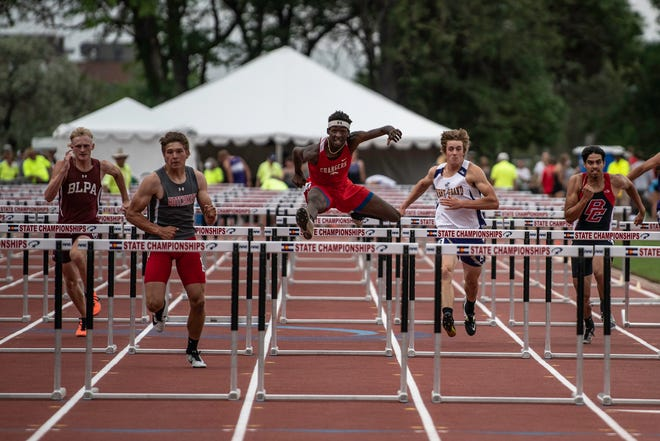 Crowley County's Rashaun McNeil, center, cruises down the track during the 110m competition at the Class 2A state track and field meet at Jefferson County Stadium on Thursday June 24, 2021.