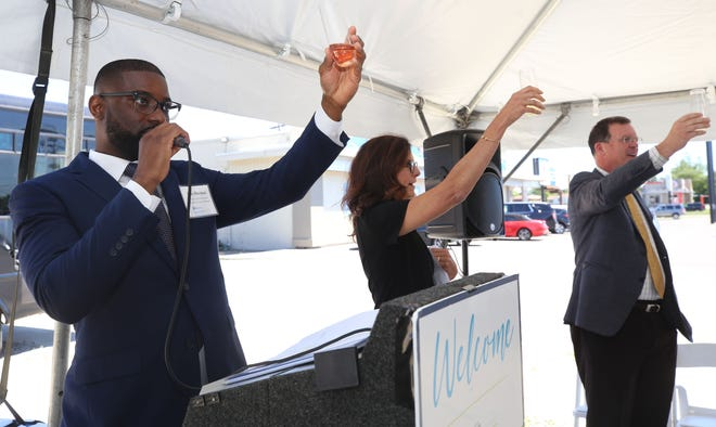 Elio Harmon, director of strategic programs for National Church Residences, Susan DiMickele, senior vice president and general counsel for NCR and Mark Ricketts, president & CEO of NCR lead a toast during the grand opening celebration for COPC SeniorSelect on June 22. The center, 1710 E. Dublin-Granville Road, is a collaboration between National Church Residences, Central Ohio Primary Care and agilon health.