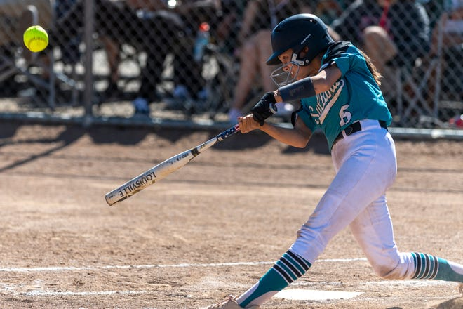 Sultana's Madelyn Torrenueva smacks a solo home run during the third inning against Rosary Academy on Thursday. The Sultans won 3-0.