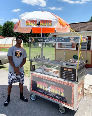 Tyrone Rhodes and his father, Claude, are both opening their own businesses in the area.