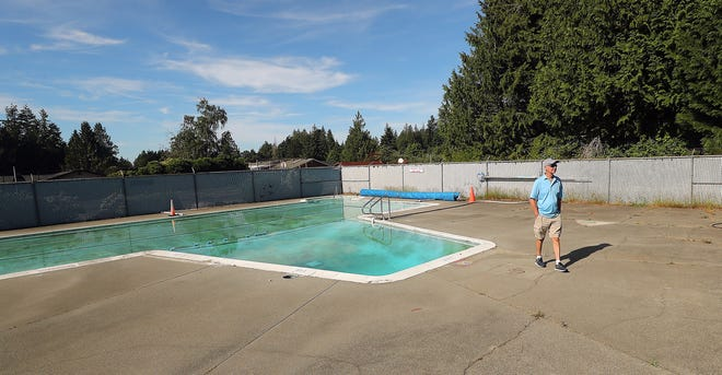 Wayne Nelson walks across the concrete pool deck at the Pinewood Community Pool in Bremerton on Friday, June 25, 2021.
