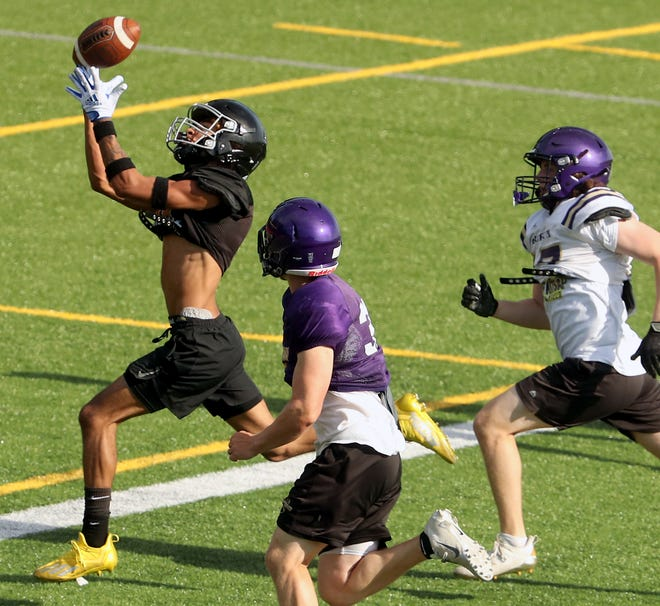 Central Kitsap's Vinny Mitchell makes a catch during a football scrimmage with North Kitsap at Cougar Field on Thursday, June 24, 2021.