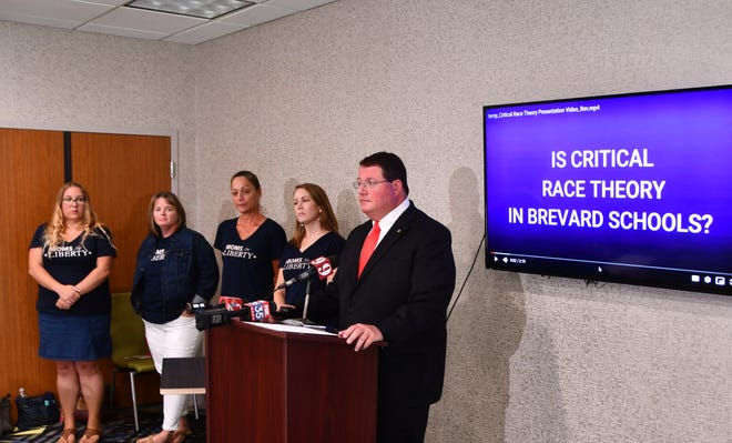 State Rep. Randy Fine, flanked by members of Moms for Liberty, at a press conference in Palm Bay earlier this year with documentation claiming that Critical Race is being taught to administrators and teachers to implement.
