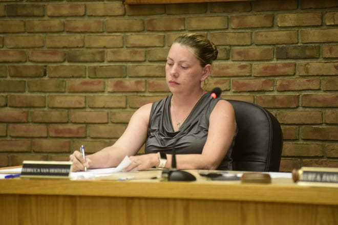 Rebecca Van Hesteren takes notes during Thursday's meeting of Bucyrus City Council.