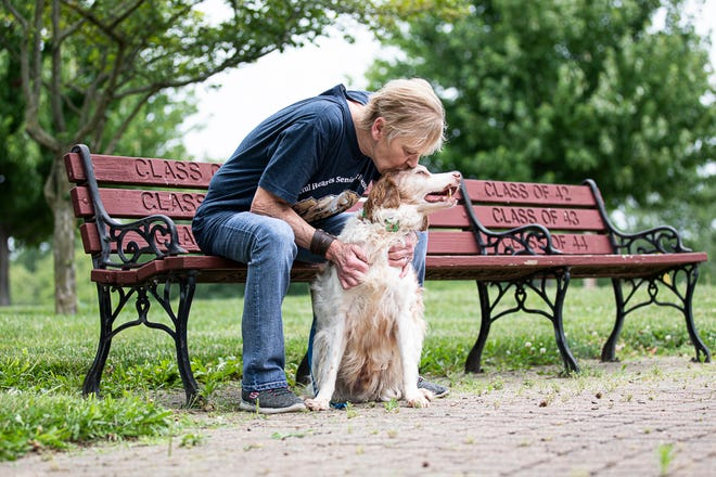 """Dona Hall kisses her rescued 15-year-old Brittany Spaniel Cayden who was removed from a cruelty situation. Hall is executive director of Grateful Hearts Senior Dog Rescue and started a Facebook page under """"Cayden, Touching Hearts Everywhere."""""""