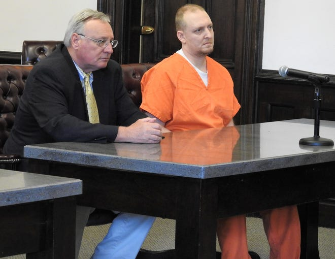 Attorney Bob Weir with client Carl Everhart Friday in Coshocton County Common Pleas Court. Everhart received 8 to 12 years in prison for charges of aggravated arson and aggravated burglary, both first-degree felonies, for setting fire to a home in Crawford Township.