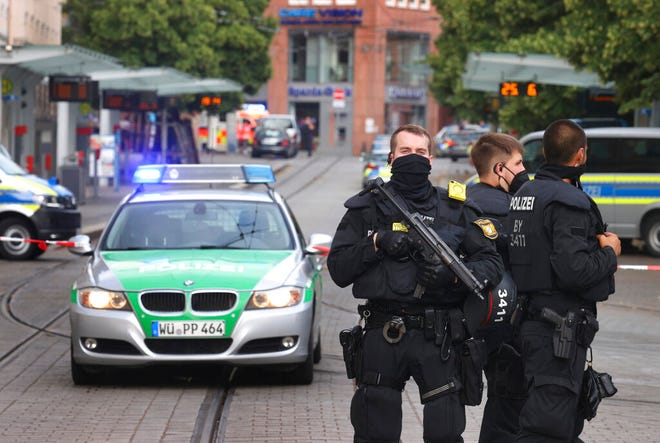 Police cars attend the scene of an incident in Wuerzburg, Germany, Friday June 25, 2021. German police say several people have been killed and others injured in a knife attack in the southern city of Wuerzburg on Friday.