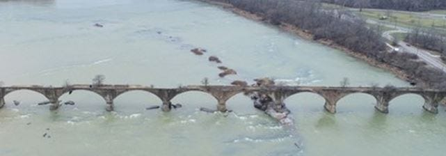 """The historic Roche de Boeuf Bridge spanning the Maumee River will be auctioned off at the Maumee Rotary Pavilion at Side Cut Metropark at 10 a.m. Wednesday. The property was appraised at $100 and is being sold """"as is."""""""