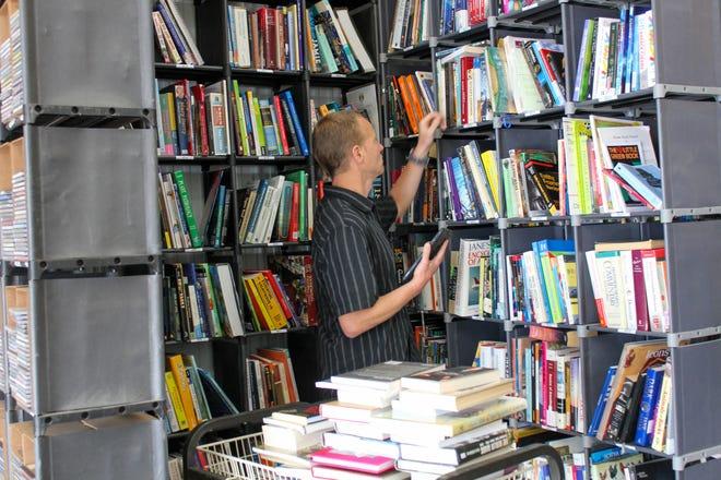 Eric Wulterkens, owner of Kings Ridge Media in Appleton, stocks books tht he will sell directly to customerrs via amazon.com.