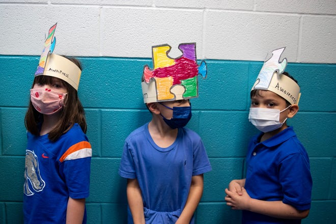 Students at Webb Elementary hold an Autism Awareness Walk on Friday, April 30, 2021.