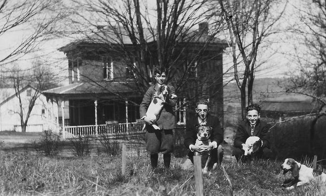 The home of the Frank M. Acton family is shown in this 1927 photo. In front are seated Frank's three sons (L to R): Joseph (1913-1978), Robert (1906-1987) and Frank II (1911-1965).