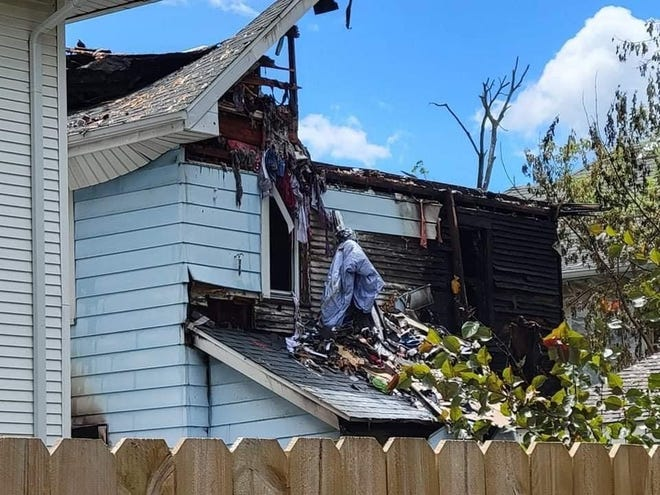 The house on Holton Street is shown after the Tuesday fire. Officials declared it a total loss and the structure was torn down on Thursday.