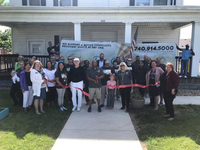 The staff at Day One Integrative Services at a ribbon cutting ceremony for its new recovery housing campus in Marion June 18, 2021. The treatment center provides services for substance abuse and mental health disorders.