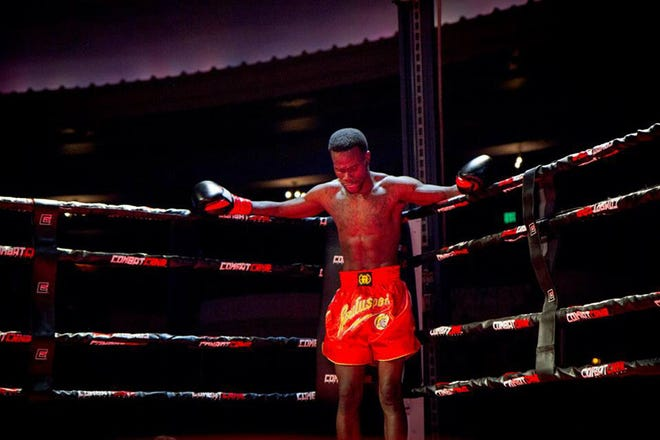 Dennis Munson Jr. during the second round of his first kickboxing match March 28, 2014. Munson collapsed after the fight and died later that night.