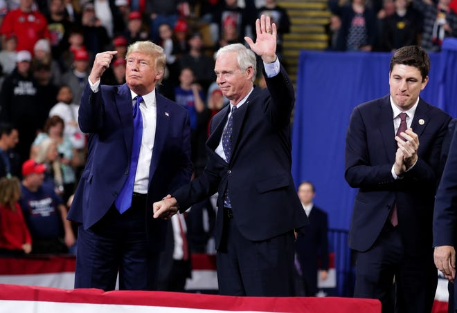 President Donald Trump invites Sen. Ron Johnson to speak at a campaign rally Jan. 14, 2020, at UW-Milwaukee Panther Arena in Milwaukee. Confidential tax records reveal that Johnson's last-minute maneuver on Trump's massive 2017 tax overhaul benefited Dick and Liz Uihlein and Diane Hendricks more than almost any others in the country — both worth billions and both among the senator's biggest donors.